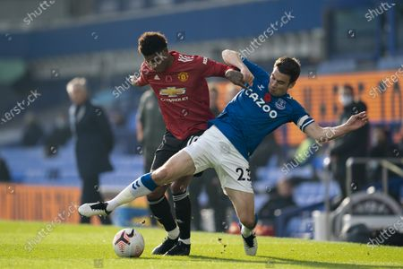 Manchester United's Marcus Rashford left fights for the ball against Everton's Seamus Coleman