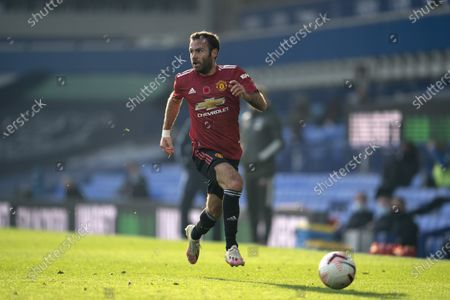 Manchester United's Juan Mata takes the ball downfield