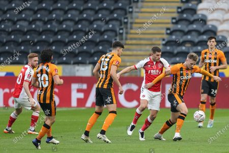 James Scott #11 of Hull City gets away from Ched Evans #9 of Fleetwood Town