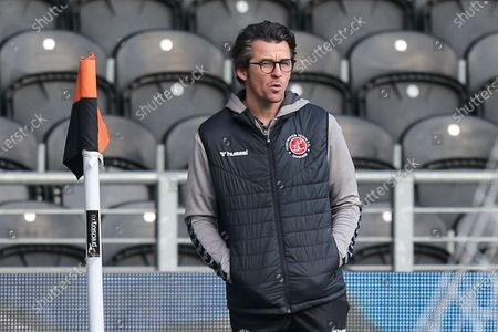 Joey Barton manager of Fleetwood Town inspects the KCOM Stadium pitch prior to kick off