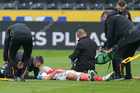 Ched Evans #9 of Fleetwood Town lies motionless in the opening minutes and receives medical attention
