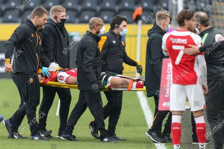 Ched Evans #9 of Fleetwood Town is stretchered off the pitch in the opening minutes of the match