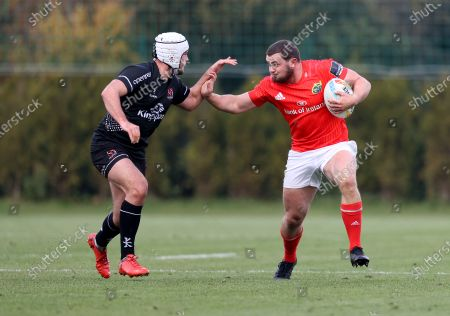 Munster's Jack Daly comes up against Ben Carson of Ulster