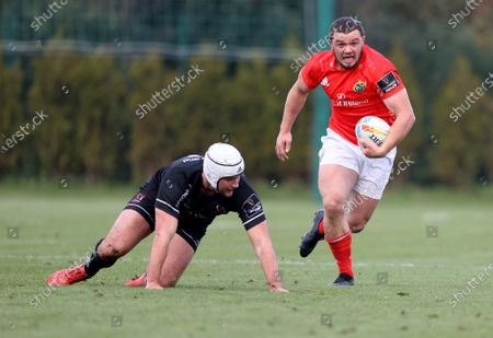 Stock Picture of Munster's Jack Daly comes up against Ben Carson of Ulster