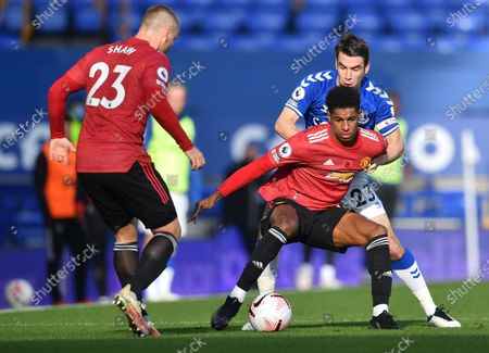 Seamus Coleman (back R) of Everton in action against Marcus Rashford (front R) of Manchester United during the English Premier League soccer match between Everton FC and Manchester United in Liverpool, Britain, 07 November 2020.
