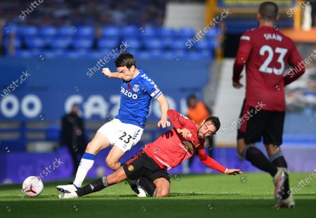 Seamus Coleman (L) of Everton in action against Bruno Fernandes (C) of Manchester United during the English Premier League soccer match between Everton FC and Manchester United in Liverpool, Britain, 07 November 2020.