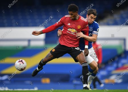 Seamus Coleman (R) of Everton in action against Marcus Rashford (L) of Manchester United during the English Premier League soccer match between Everton FC and Manchester United in Liverpool, Britain, 07 November 2020.