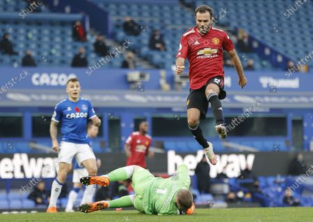 Everton's goalkeeper Jordan Pickford (bottom) clears the ball from Juan Mata (up) of Manchester United during the English Premier League soccer match between Everton FC and Manchester United in Liverpool, Britain, 07 November 2020.