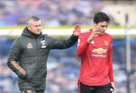Manchester United manager Ole Gunnar Solskjaer (L) and Victor Lindelof (R) react after the English Premier League soccer match between Everton FC and Manchester United in Liverpool, Britain, 07 November 2020.