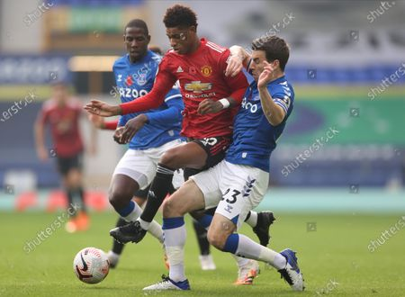 Seamus Coleman (R) of Everton in action against Marcus Rashford (C) of Manchester United during the English Premier League soccer match between Everton FC and Manchester United in Liverpool, Britain, 07 November 2020.