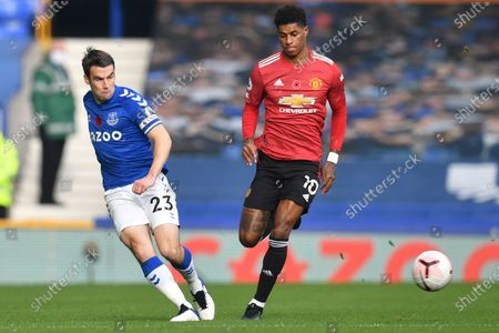 Everton's Seamus Coleman, left, is challenged by Manchester United's Marcus Rashford during the English Premier League soccer match between Everton and Manchester United at the Goodison Park stadium in Liverpool, England