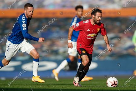 Manchester United's Juan Mata, right, in action during the English Premier League soccer match between Everton and Manchester United at the Goodison Park stadium in Liverpool, England