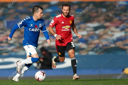 Everton's Bernard, left, is challenged by Manchester United's Juan Mata during the English Premier League soccer match between Everton and Manchester United at the Goodison Park stadium in Liverpool, England