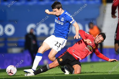 Stock Image of Everton's Seamus Coleman is tackled by Manchester United's Bruno Fernandes during the English Premier League soccer match between Everton and Manchester United at the Goodison Park stadium in Liverpool, England