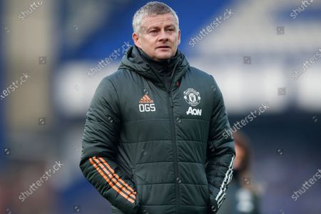 Manchester United's manager Ole Gunnar Solskjaer walks to the bench during the English Premier League soccer match between Everton and Manchester United at the Goodison Park stadium in Liverpool, England