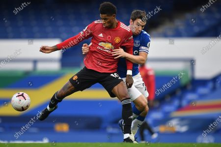 Stock Photo of Manchester United's Marcus Rashford, left, fights for the ball with Everton's Seamus Coleman during the English Premier League soccer match between Everton and Manchester United at the Goodison Park stadium in Liverpool, England