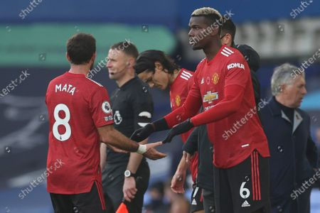 Stock Photo of Manchester United's Paul Pogba, right, replaces Manchester United's Juan Mata during the English Premier League soccer match between Everton and Manchester United at the Goodison Park stadium in Liverpool, England