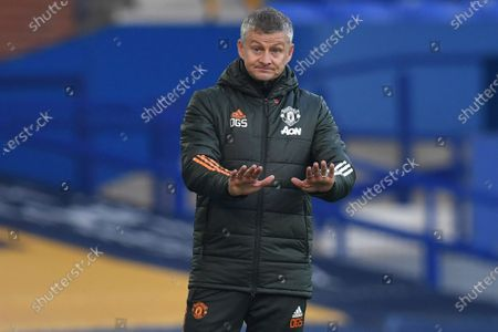Manchester United's manager Ole Gunnar Solskjaer gestures during the English Premier League soccer match between Everton and Manchester United at the Goodison Park stadium in Liverpool, England