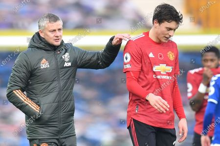 Manchester United's manager Ole Gunnar Solskjaer greets Manchester United's Victor Lindelof at the end of the English Premier League soccer match between Everton and Manchester United at the Goodison Park stadium in Liverpool, England, . Manchester United won 3:1