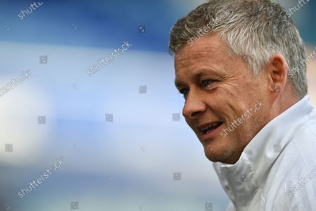 Manchester United's manager Ole Gunnar Solskjaer grimaces ahead of the English Premier League soccer match between Everton and Manchester United at the Goodison Park stadium in Liverpool, England
