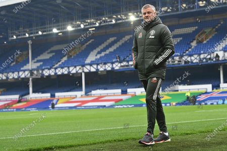 Manchester United's manager Ole Gunnar Solskjaer walks to the bench ahead of the English Premier League soccer match between Everton and Manchester United at the Goodison Park stadium in Liverpool, England