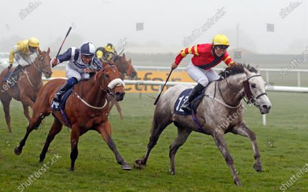 Stock Photo of ZIP (right, Jessica Cooley) beats GRAVITY FORCE (left) in The Ryan Moore Columns On Betting Betfair Apprentice Handicap Doncaster