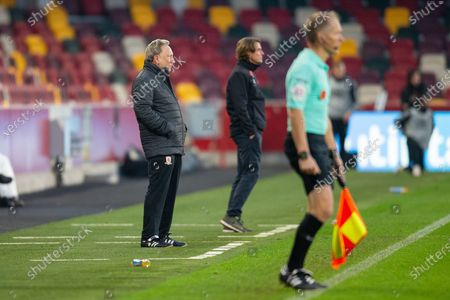 Middlesbrough manager Neil Warnock Brentford manager Thomas Frank assistant referee Michael George during the EFL Sky Bet Championship match between Brentford and Middlesbrough at Brentford Community Stadium, Brentford