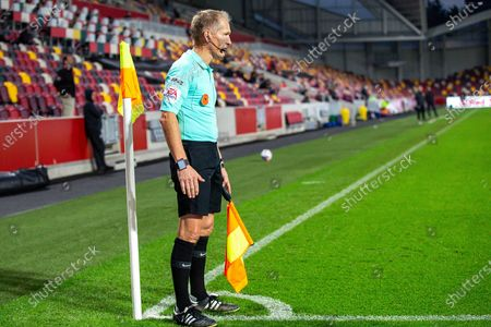 Assistant referee Michael George during the EFL Sky Bet Championship match between Brentford and Middlesbrough at Brentford Community Stadium, Brentford