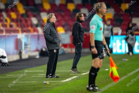 Middlesbrough manager Neil Warnock, Brentford manager Thomas Frank, assistant referee Michael George during the EFL Sky Bet Championship match between Brentford and Middlesbrough at Brentford Community Stadium, Brentford