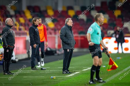 Middlesbrough assistant manager Kevin Blackwell, Brentford manager Thomas Frank, Middlesbrough manager Neil Warnock, assistant referee Michael George George, during the EFL Sky Bet Championship match between Brentford and Middlesbrough at Brentford Community Stadium, Brentford