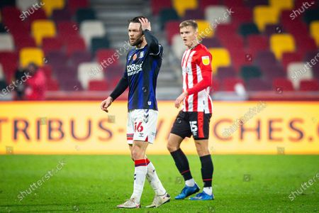 Middlesbrough midfielder Jonathan Howson (16) and Brentford forward Marcus Forss (15) during the EFL Sky Bet Championship match between Brentford and Middlesbrough at Brentford Community Stadium, Brentford