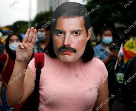 A Thai LGBT activist wearing a mask of legendary British singer and songwriter Freddie Mercury flashes three-finger salute during a demonstration calling for the rights for the LGBT community as part of the ongoing anti-government protests in Bangkok, Thailand, 07 November 2020. Hundreds of members of the Thai LGBT community gathered for a demonstration opposing the discrimination against the lesbian, gay, bisexual and transgender (LGBT) community and also to protest against the government, calling for the resignation of the Thai prime minister, the rewriting of the new constitution and the monarchy reform.