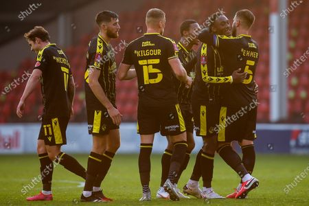 Brandon Hanlan of Bristol Rovers celebrates with teammates after scoring a goal to make it 2-0