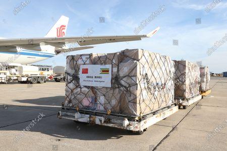 Medical supplies donated by China are unloaded from a plane at Robert Mugabe International Airport in Harare, Zimbabwe, May 11, 2020.