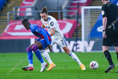 Leeds United defender Luke Ayling (2) tackles Crystal Palace forward Wilfried Zaha (11) during the Premier League match between Crystal Palace and Leeds United at Selhurst Park, London