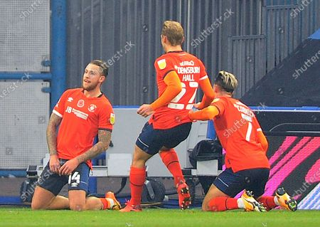 Luton Town's George Moncur (lefft) celebrates scoring his sides first goal with Kiernan Dewsbury-Hall and  Harry Cornick