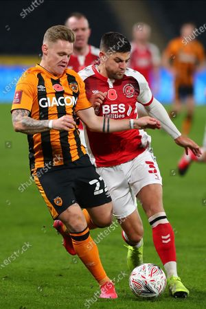 Hull City's Thomas Mayer ,Fleetwood Town Harrison Holgate during the The FA Cup match between Hull City and Fleetwood Town at the KCOM Stadium, Kingston upon Hull