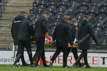 Ched Evans stretchered off  during the The FA Cup match between Hull City and Fleetwood Town at the KCOM Stadium, Kingston upon Hull