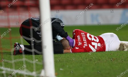 Charlie Barker of Charlton Athletic has medical treatment during Charlton Athletic vs Plymouth Argyle, Emirates FA Cup Football at The Valley on 7th November 2020