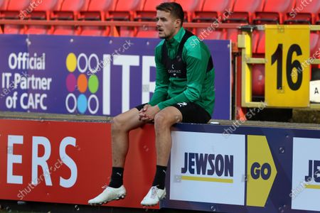 Scott Wootton of Plymouth Argyle sitting down after warming up during Charlton Athletic vs Plymouth Argyle, Emirates FA Cup Football at The Valley on 7th November 2020