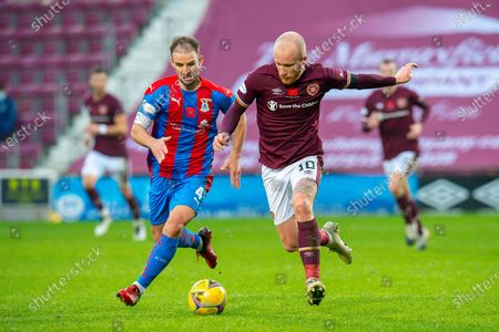 Sean Walsh (#4) of Inverness Caledonian Thistle FC tracks the run of Liam Boyce (#10) of Heart of Midlothian FC during the SPFL Championship match between Heart of Midlothian and Inverness CT at Tynecastle Park, Edinburgh