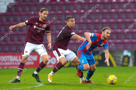 Sean Walsh (#4) of Inverness Caledonian Thistle FC gets to the ball ahead of Olly Lee (#8) and Peter Haring (#5) of Heart of Midlothian FC during the SPFL Championship match between Heart of Midlothian and Inverness CT at Tynecastle Park, Edinburgh