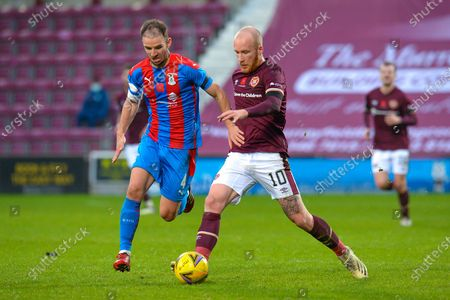 Stock Picture of Liam Boyce (#10) of Heart of Midlothian FC tries to run past Sean Walsh (#4) of Inverness Caledonian Thistle FC during the SPFL Championship match between Heart of Midlothian and Inverness CT at Tynecastle Park, Edinburgh