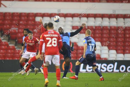 Wycombe Wanderers Forward Adebayo Akinfenwa trys to control the ball during the EFL Sky Bet Championship match between Nottingham Forest and Wycombe Wanderers at the City Ground, Nottingham