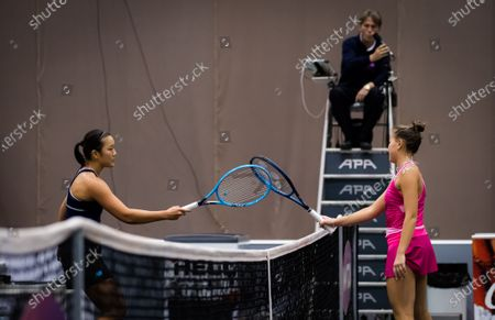 Stock Image of Harmony Tan of France & Kamilla Rakhimova of Russia meet at the net during the first qualifications round at the 2020 Upper Austria Ladies Linz WTA International tennis tournament