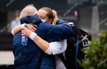 Sabine Lisicki of Germany celebrates with her father after winning the first qualifications round at the 2020 Upper Austria Ladies Linz WTA International tennis tournament