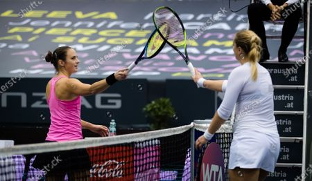 Bibiane Schoofs of the Netherlands & Sabine Lisicki of Germany meet at the net after the first qualifications round at the 2020 Upper Austria Ladies Linz WTA International tennis tournament
