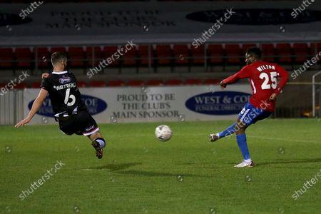 Scott Wilson of Dagenham and Redbridge scores the second goal for his team during Dagenham & Redbridge vs Grimsby Town, Emirates FA Cup Football at the Chigwell Construction Stadium on 7th November 2020
