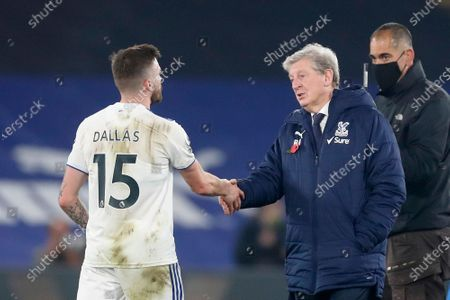 Crystal Palace's manager Roy Hodgson shales hands with Leeds United's Stuart Dallas at the end of the English Premier League soccer match between Crystal Palace and Leeds United at the Selhurst Park stadium in London, England, . Crystal Palace won 4-1