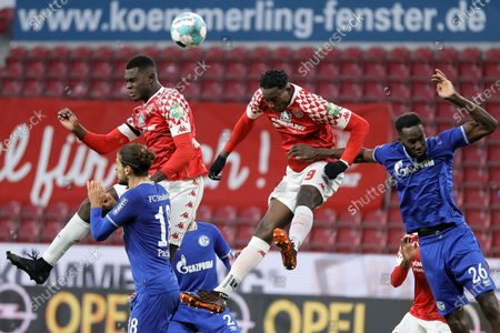 Mainz's Moussa Niakhate (L-top) and Jean-Philippe Mateta (2-R) in action against Schalke's Goncalo Paciencia (L-buttom) and Salif Sane (R) during the German Bundesliga soccer match between 1. FSV Mainz 05 and FC Schalke 04 in Mainz, Germany, 07 November 2020.